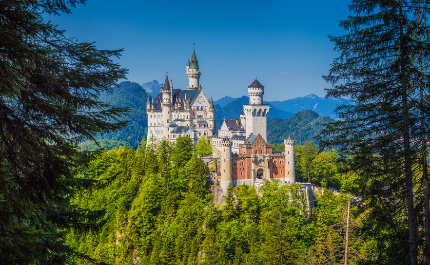 Famous Neuschwanstein Castle with scenic mountain landscape