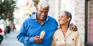 senior couple walking eating ice cream