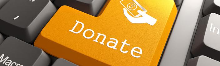 Orange Donate Button on Computer Keyboard