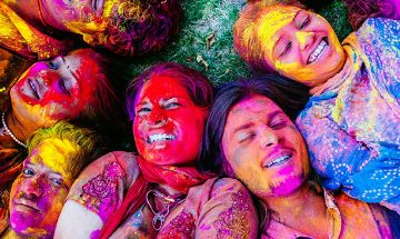Photo of faces covered in paint at festival