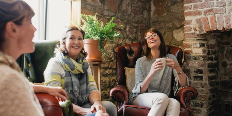 group of female friends drinking coffee