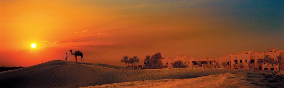 Sunset over the desert of united arab emirates
