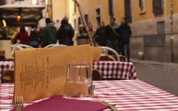 Close up of a table at an outdoor Italian restaurant