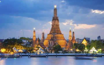 View of Wat Arun Temple from the Chao Phraya river in Bangkok