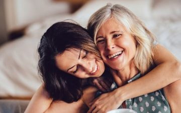 senior woman and her daughter embrace