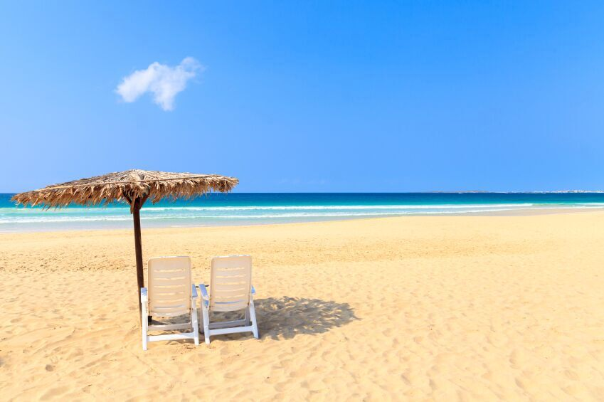 Parasol and Chair on a beach in Boavista, Cape Verde
