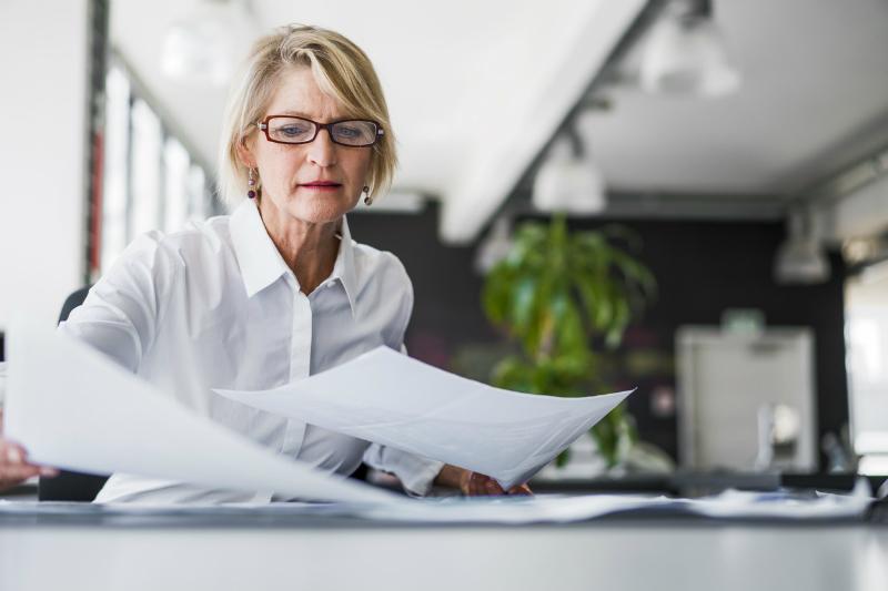 Businesswoman looking at investment portfolio