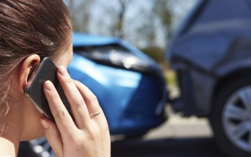 On the phone following a car accident
