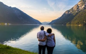 older couple looking at lake achen in austria