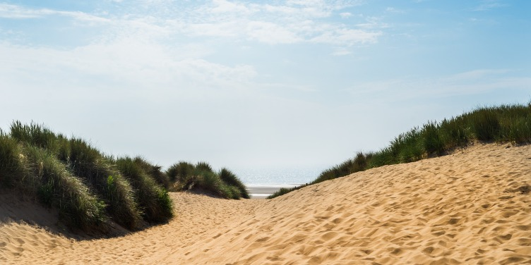 an image of sand dunes with grassy banks in Formby, Merseyside