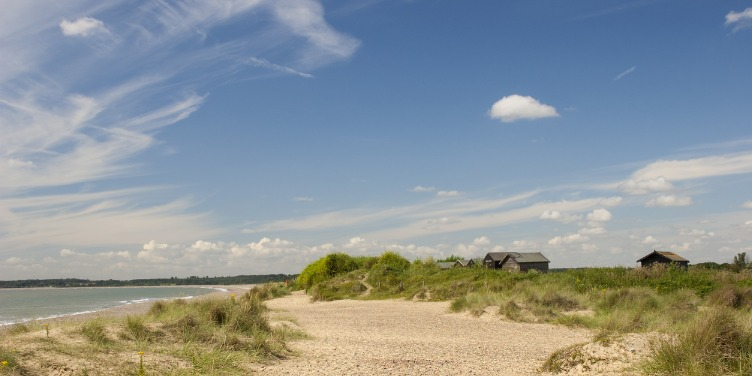 an image of a house behind a dune in Walberswick, Suffolk