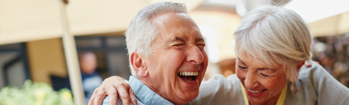 Mature couple laughing