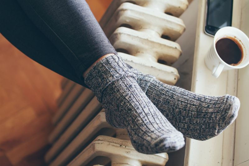 Warming feet on a radiator