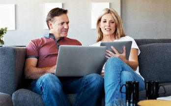 Mature couple comparing insurance