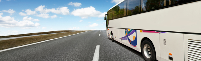 Close up of coach driving down a motorway