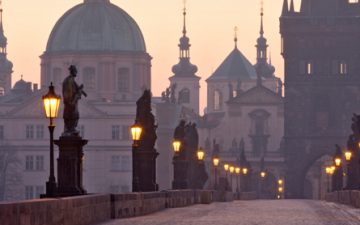 A view of Charles Bridge in Prague, at dusk