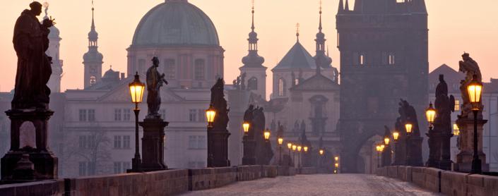 A view of Charles Bridge in Prague, at dusk