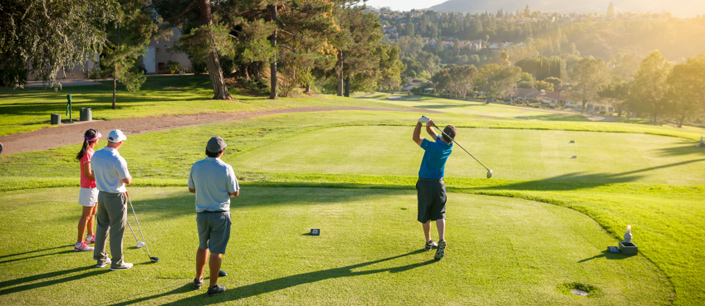 A group of friends playing a riveting game of golf on a sunny green