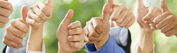 Many hands giving a thumbs up in front of a green background