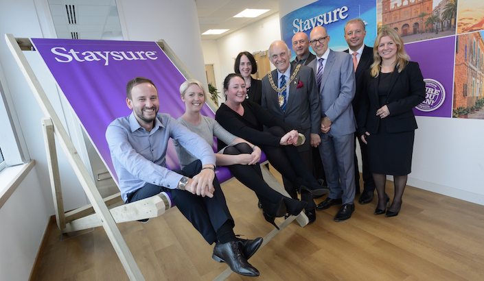 Staysure Travel Staff on a giant deckchair at the launch of the new Coventry office