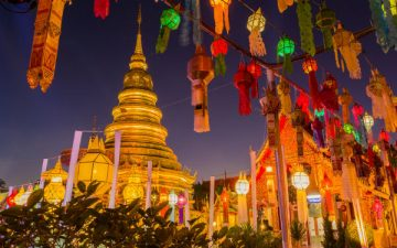 Golden pagoda and lanterns in Bangkok, Thailand