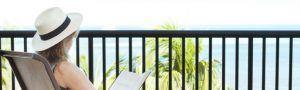 Woman reading on balcony