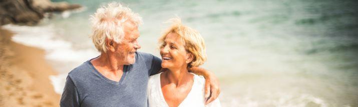 Mature couple walking along the beach