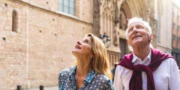 senior couple exploring european old town