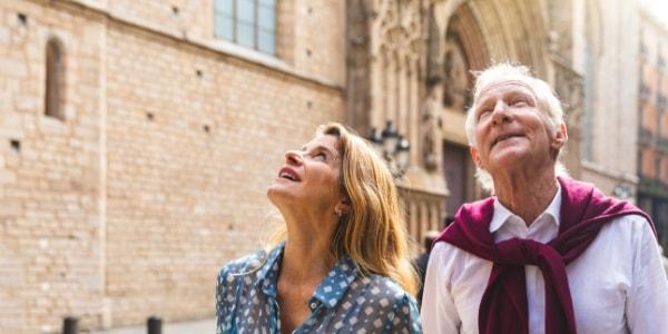 senior couple exploring european old town