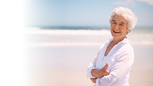 Senior woman smiling on the beach
