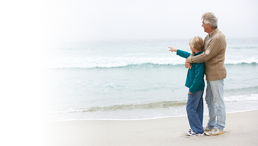 Grandson and grandfather on a beach