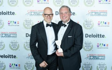 Ryan Howsam (Chairman) and Chris Rolland (CEO) collect Staysure's Best Travel Insurance Provider award