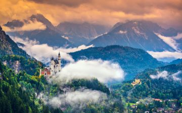 Wide-view of magnificent Neuschwanstein Castle in mountains
