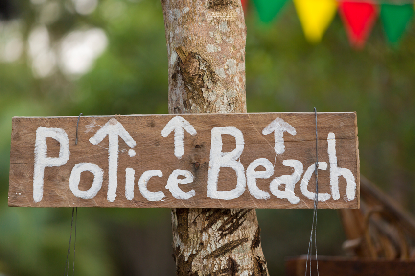 Police beach wooden sign hanging on tree, Koh Rong Island