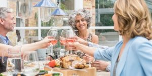 Over 50s drinking wine at dinnertable