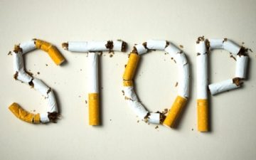cigarettes arranged in letters to spell stop