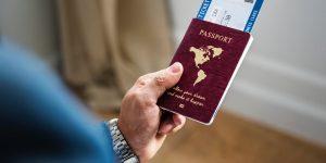 Man's hand holding passport