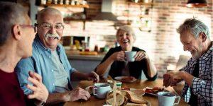 group of seniors eating breakfast