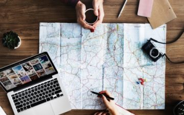Map with Laptop and Travel Accessories