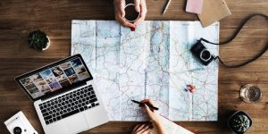 Travel plans with map camera and laptop