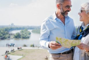 senior couple on holiday looking at map