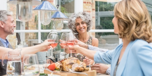 Over 50s eating healthy over dinner table