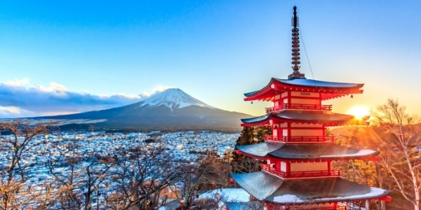 Traditional Japanese Building in foreground with Mount Fuji in background