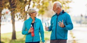 senior couple running outdoors