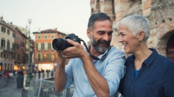 older couple on holiday with camera