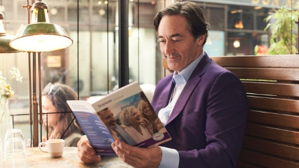 Man Reading Staysure Policy Book