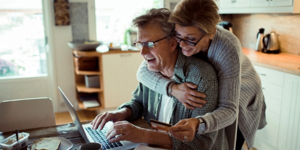 couple in kitchen doing online banking