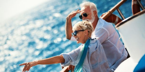 senior couple on cruise ship smiling