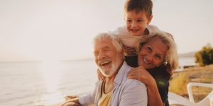 randparents and grand son smiling on holiday
