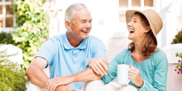 senior couple drink coffee in sunshine
